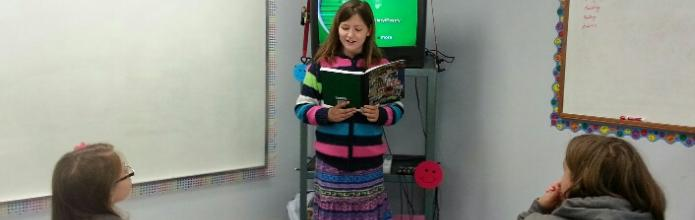 Student reading creative writing composition.