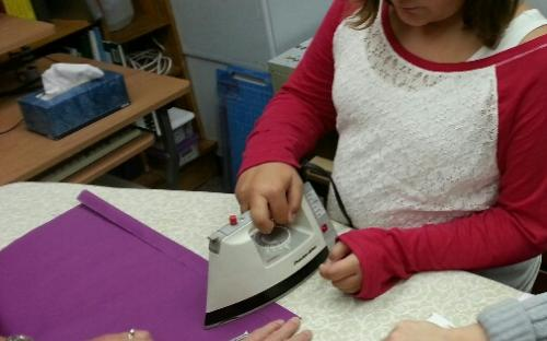 Students learn to carry out all the tasks associated with a sewing project.
